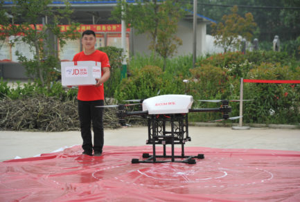 "JD.com local ""village promoter"" retrieves packages from a JD drone in …"